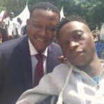 gradus ochieng during representing PWDS 3rd national uhc conference poses for aphoto with dr alfred mutua kisumu county