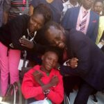 gradus ochieng during representing PWDS 3rd national uhc conference poses for aphoto with prof.peter anyang nyogo kisumu county